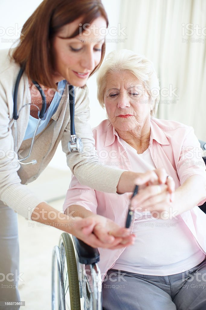 Knowledge is empowering - Senior Care royalty-free stock photo