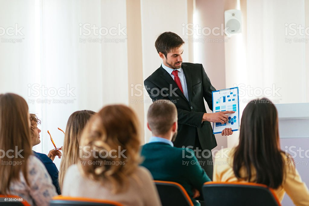 Knowledge transfer from marketing professor to students stock photo