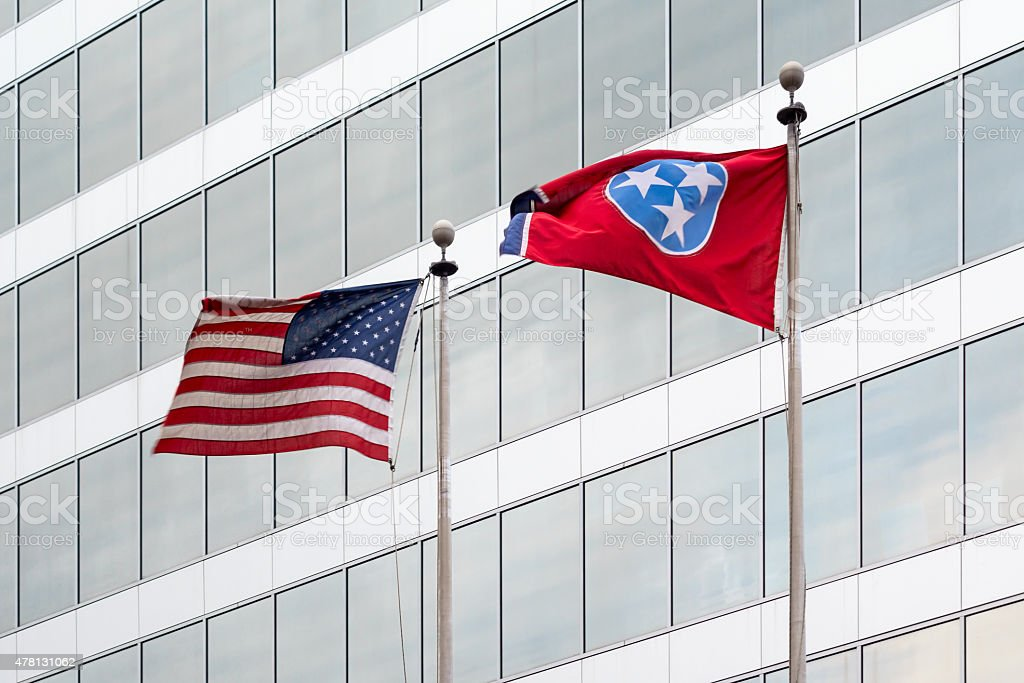 Knoxville Office Building with USA and Tennessee Flag stock photo