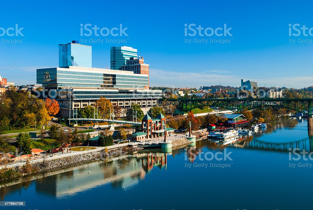 Knoxville skyline, a bridge, and the Tennessee River stock photo
