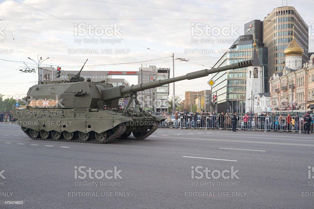 2S35 Koalitsiya-SV self-propelled howitzer and people on roadside stock photo