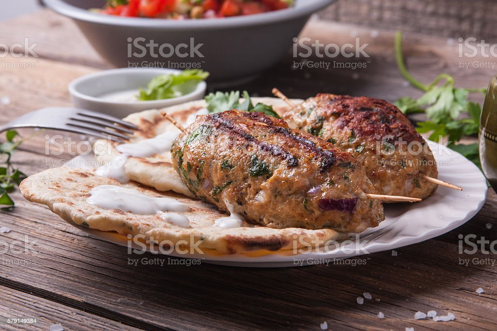 Kofta with flatbread on plate with salad stock photo