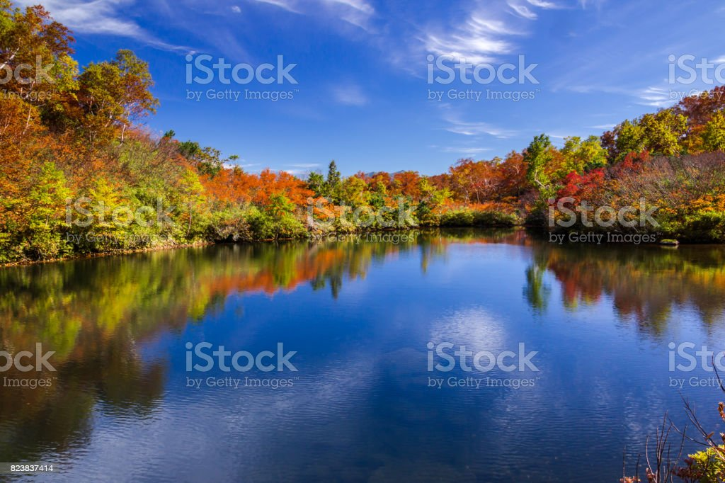 Kogen onsen pond and autumn colors stock photo