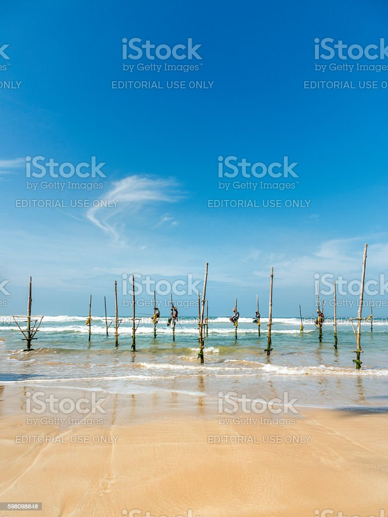Koggala beach, village near Galle, stilt fishermen stock photo