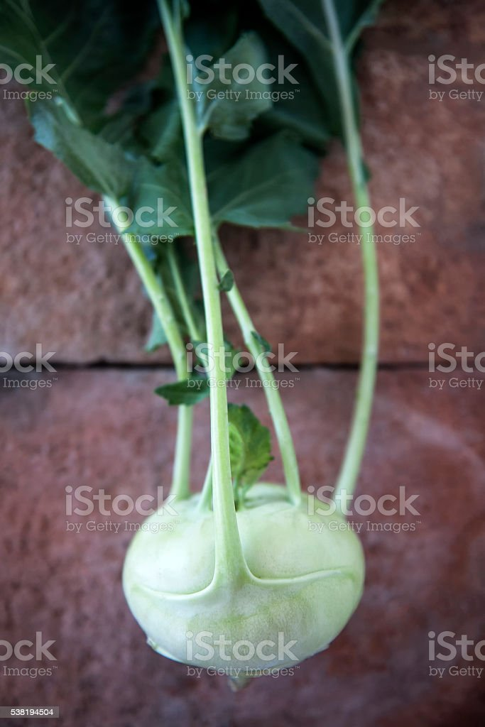 Kohlrabi on a Rustic Background stock photo
