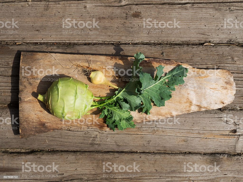 Kohlrabi on wooden plate stock photo