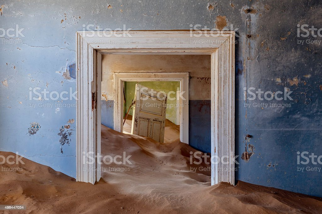 Kolmanskop Room and Sand Dunes stock photo
