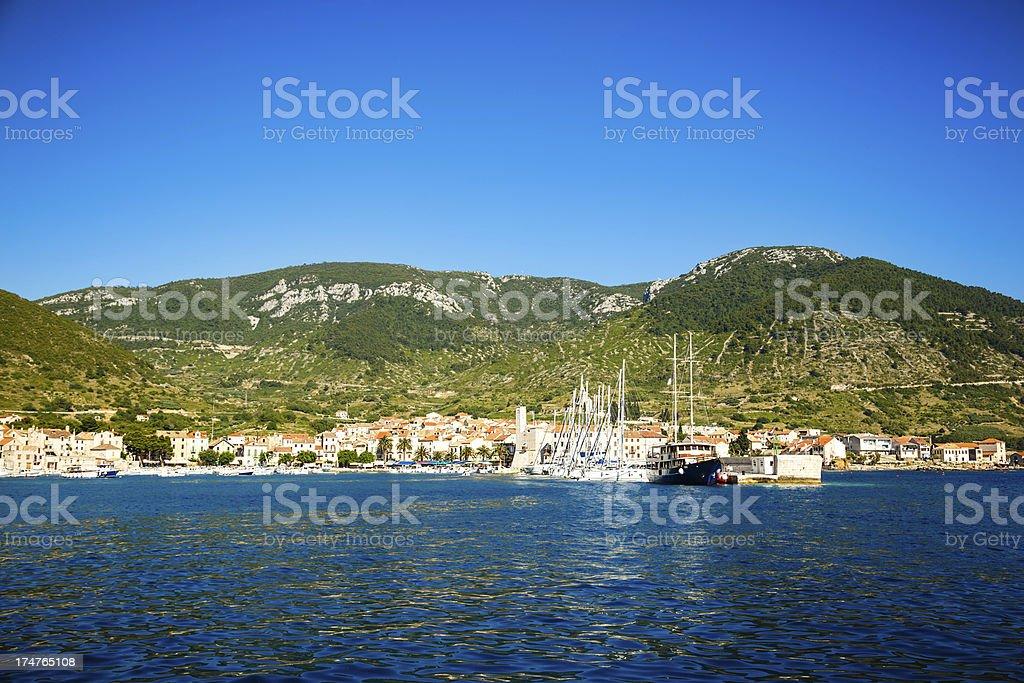Komiza town with marina on island Vis, Croatia royalty-free stock photo