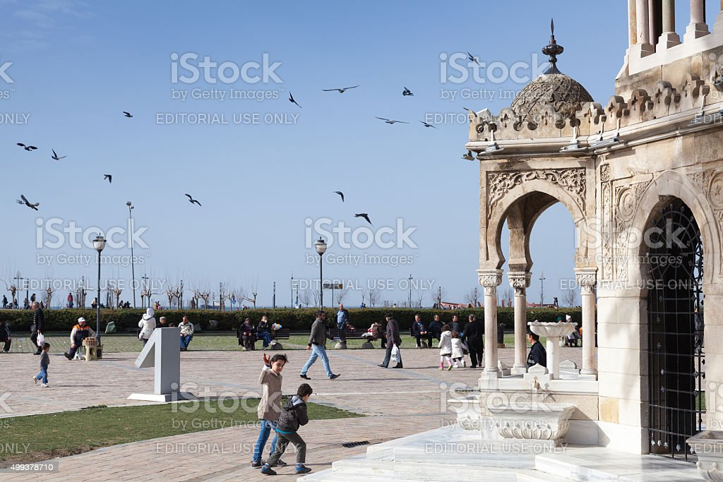 Konak Square, people walk near clock tower stock photo