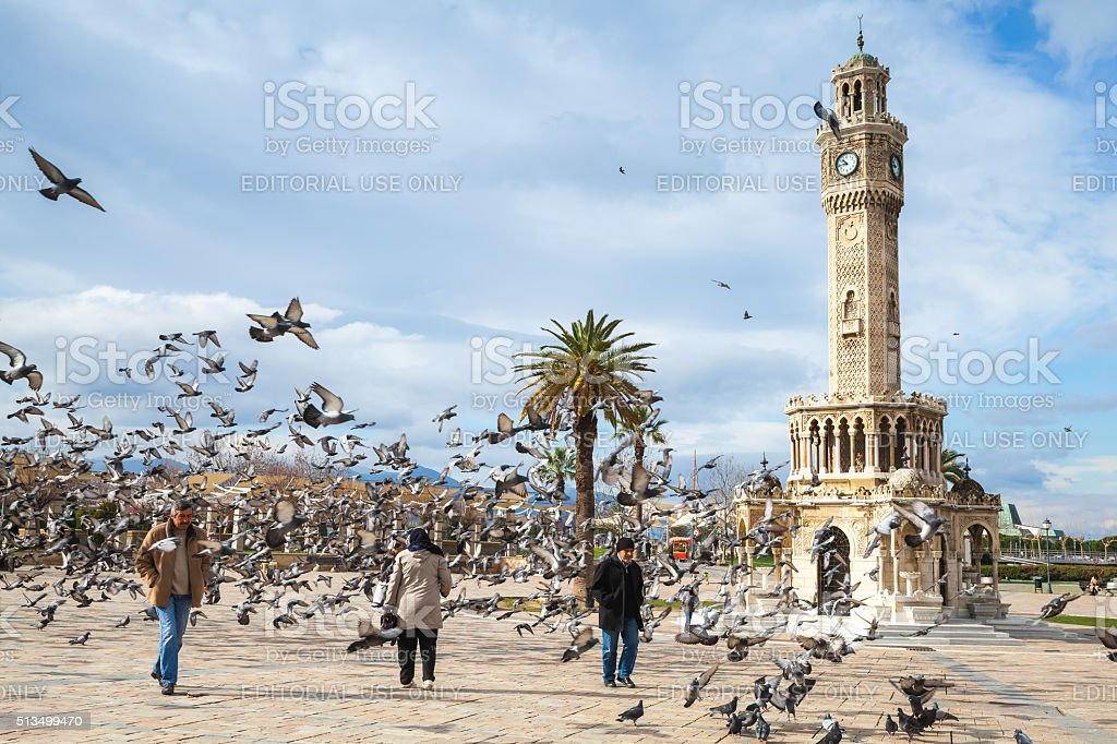 Konak Square, walking ordinary people and doves stock photo