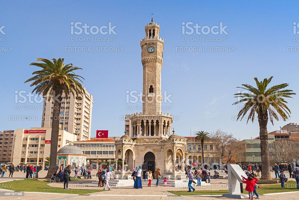 Konak Square with tourists walking near clock tower stock photo