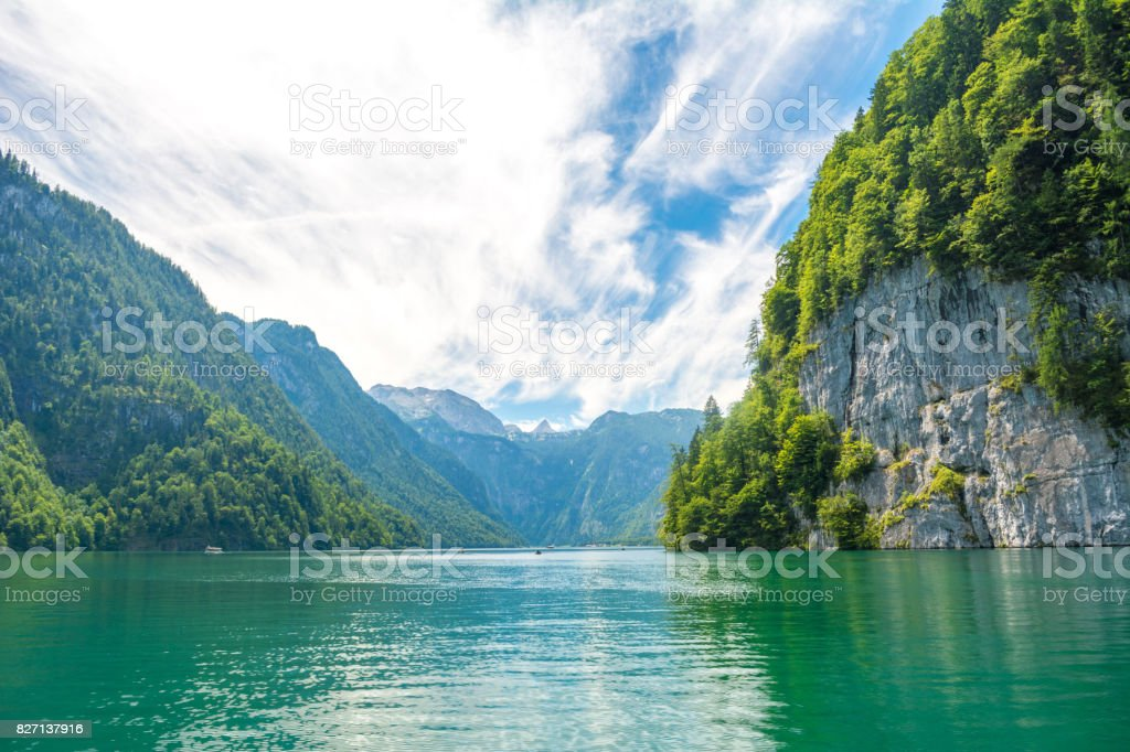 Konigssee lake with clear green water, reflection, mountins and sky background, Bavaria, Germany stock photo