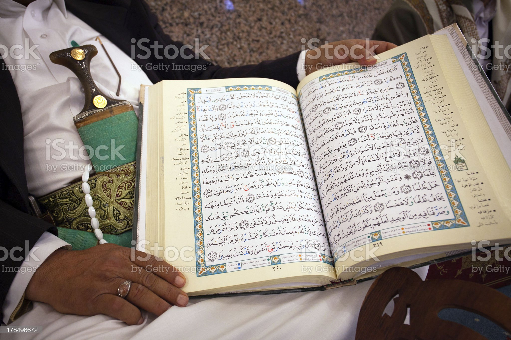 Korans in the hands of a muslim, Yemen royalty-free stock photo