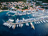 Korcula town and marina with sailboats from above