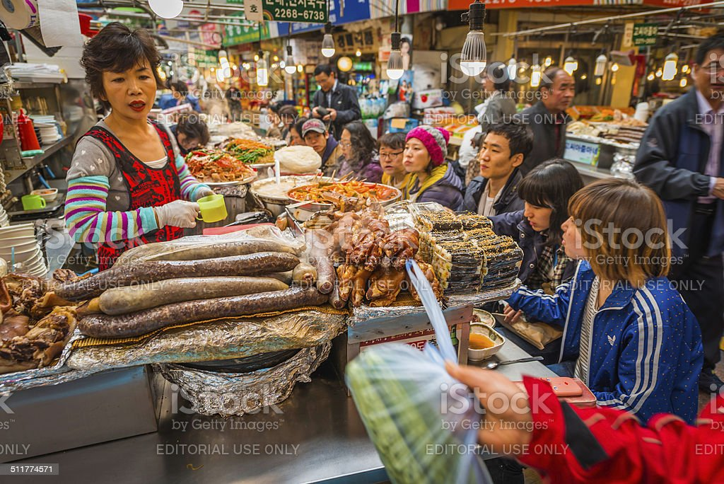 Korea cook and customers at busy market food stall Seoul stock photo