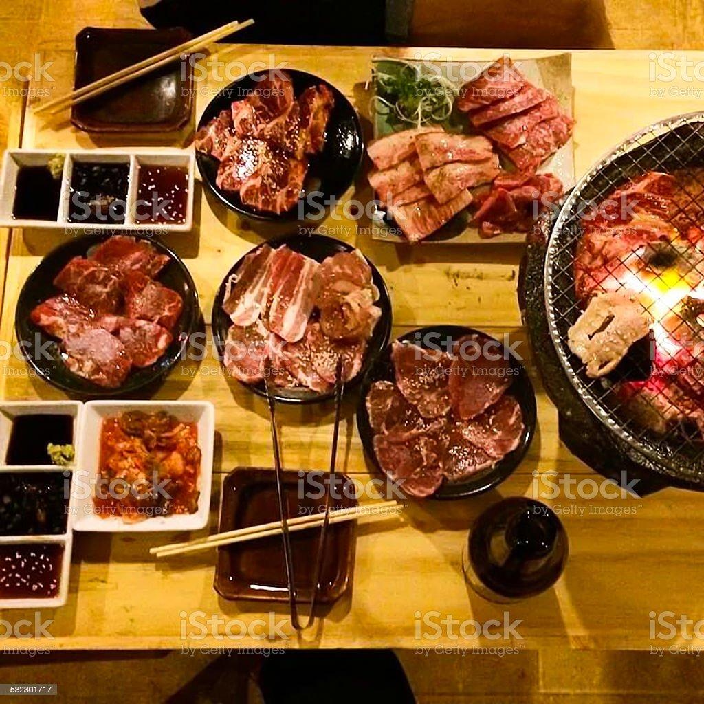 Korean BBQ pork and banchan - Stock Image stock photo