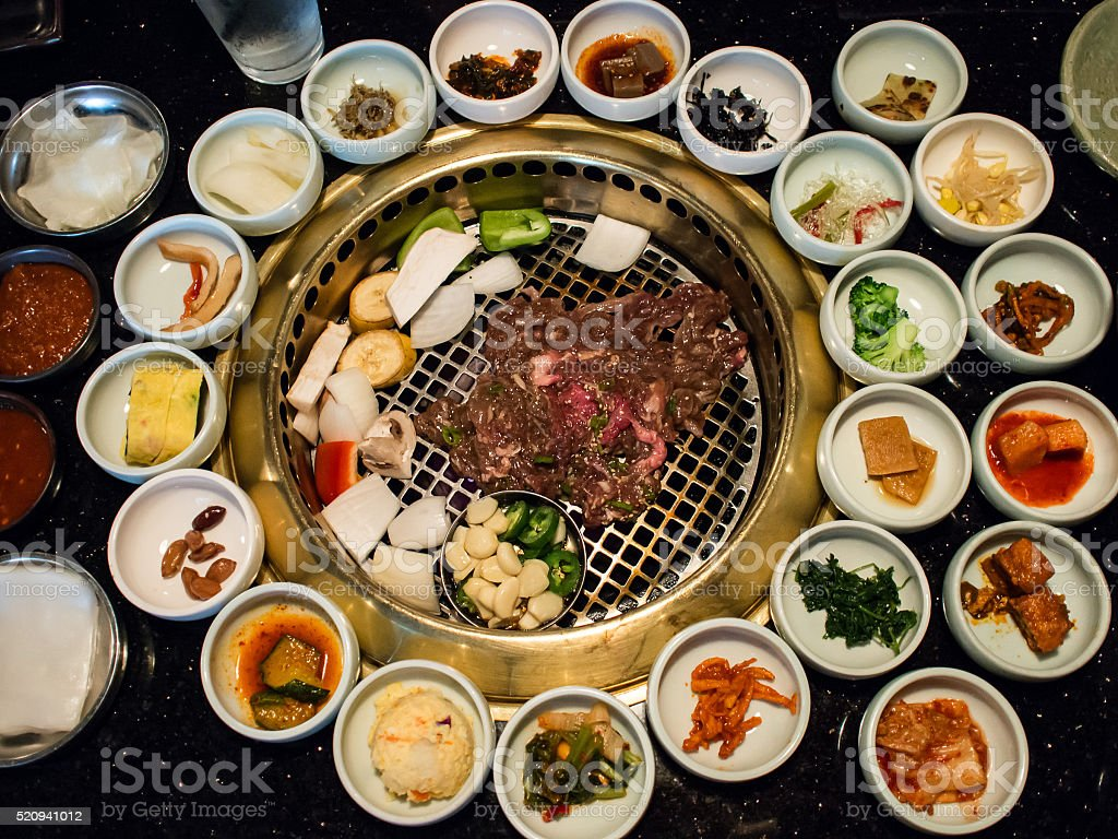 Korean BBQ with full side dishes stock photo