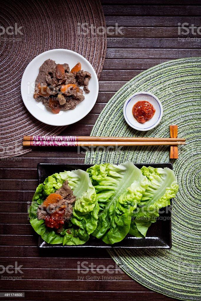 Korean Bulgogi with ssamjang sauce served with fresh lettuce stock photo