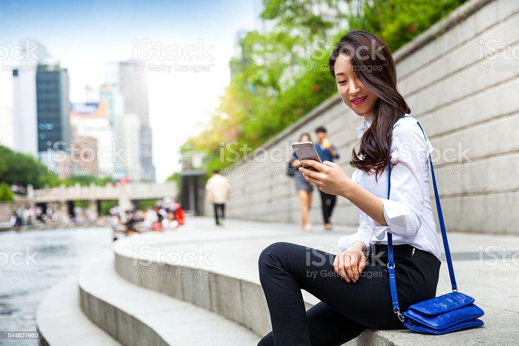 Korean Businesswoman in Seoul downtown having a break stock photo