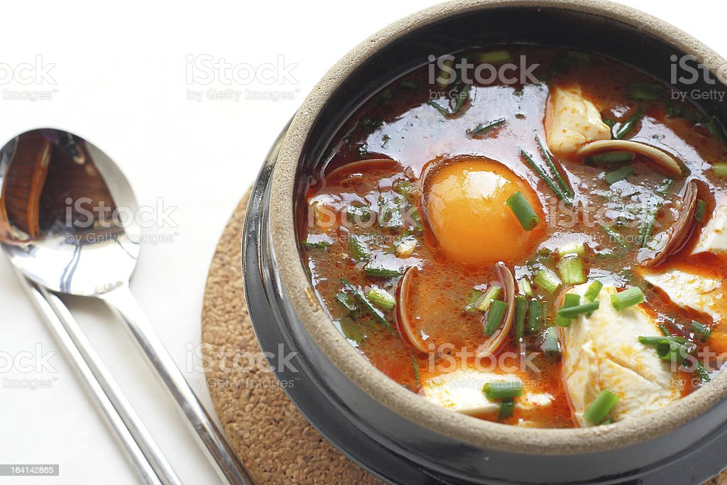 Korean cuisine, Sundubu Jjigae and vegetable stew royalty-free stock photo