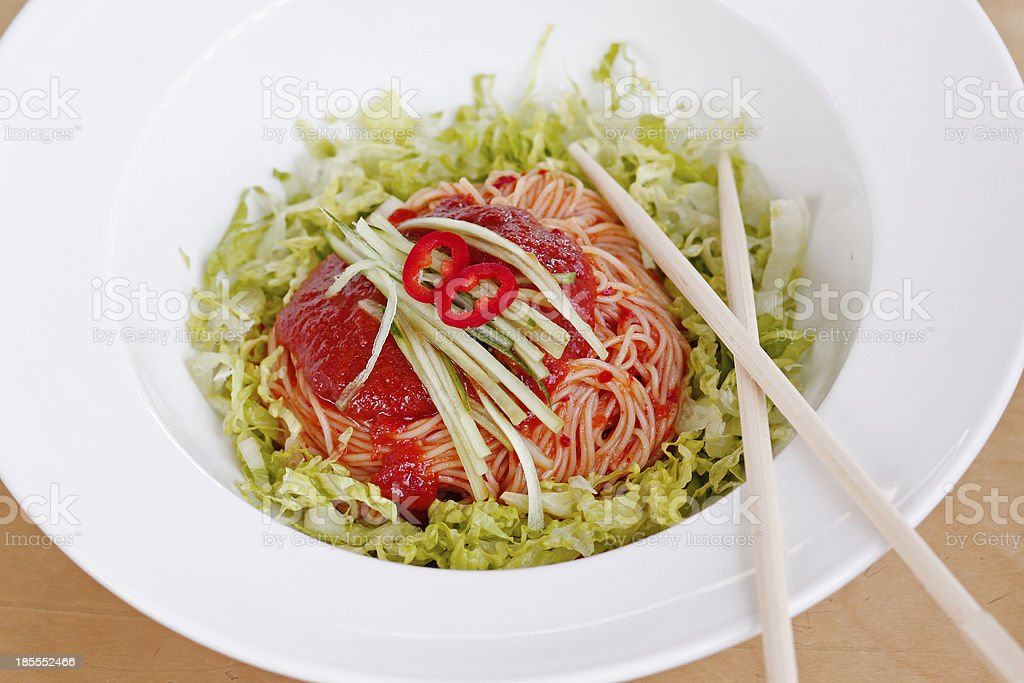Korean food, spicy mixed noodle with lettuce royalty-free stock photo