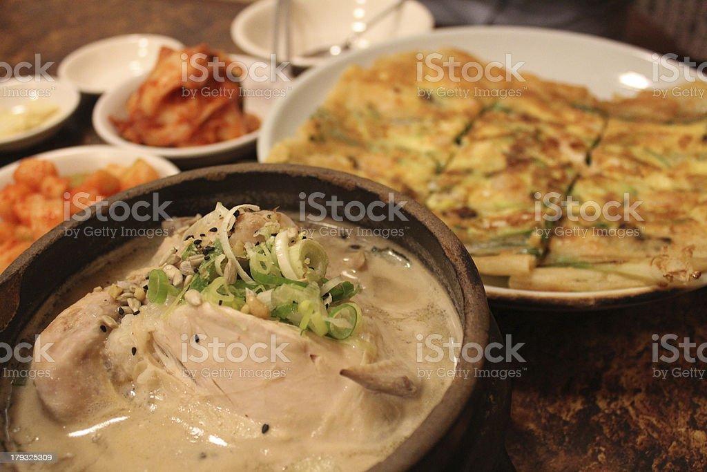 korean ginseng chicken soup and seafood pancake royalty-free stock photo