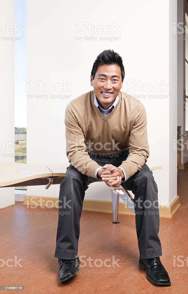 Korean Man, Business Casual, Sitting on Bench royalty-free stock photo