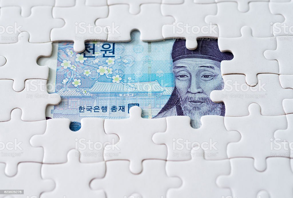 Korean paper currency with jigsaw puzzle stock photo