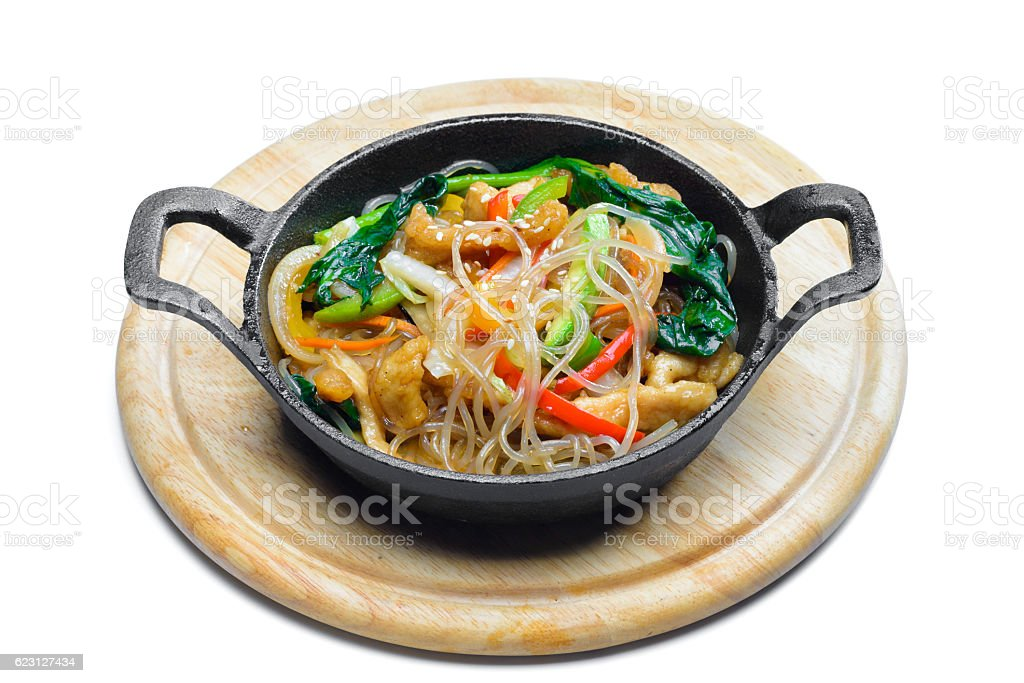 Korean rice noodle with vegetables on frying pan stock photo
