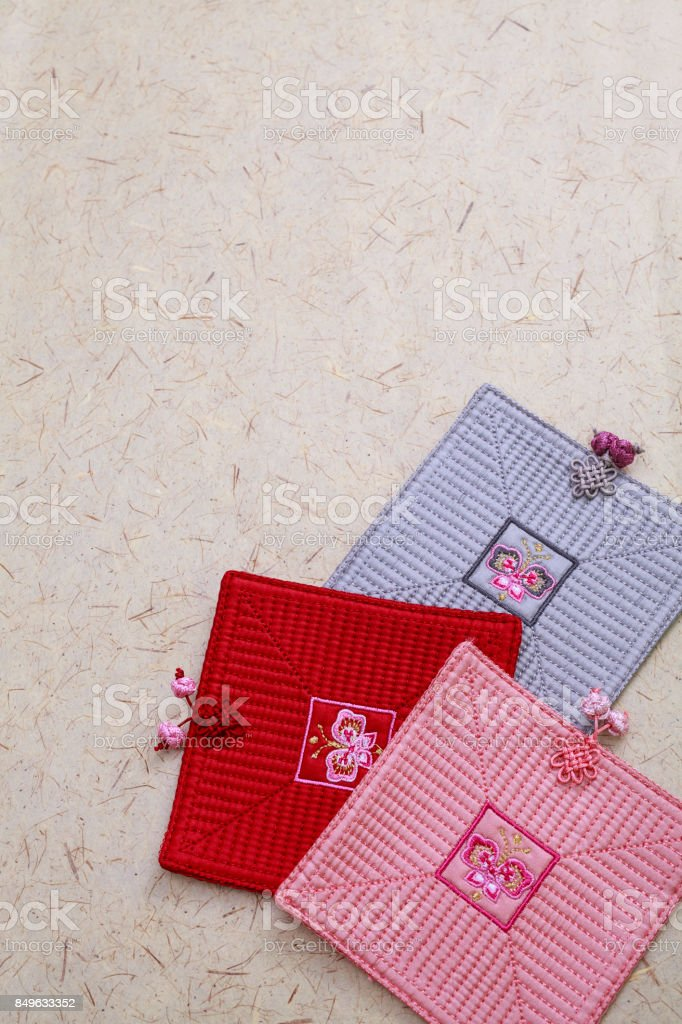 Korean Thanksgiving Day Background -  Embroidered coasters of Korean pattern stock photo