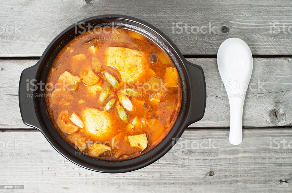Korean traditional Kimchi soup in a clay pot stock photo
