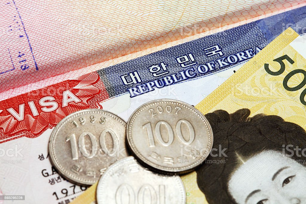 Korean visa in a passport and currency stock photo