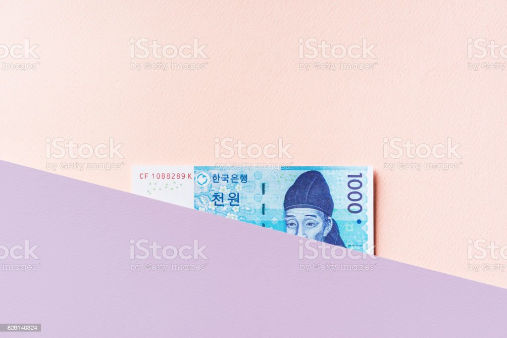 Korean won banknote between pastel colored layers stock photo