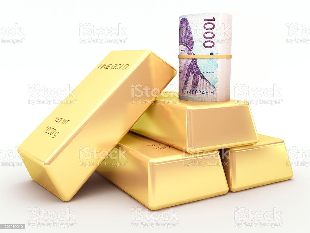 Korean won banknote roll and gold bars stock photo