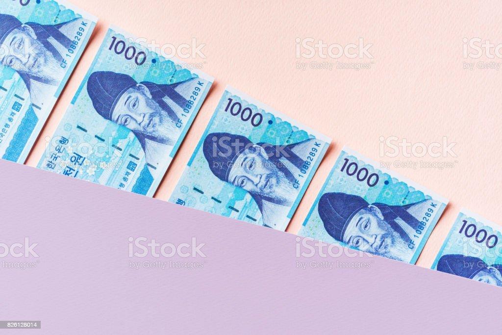 Korean won banknotes between pastel colored layers stock photo