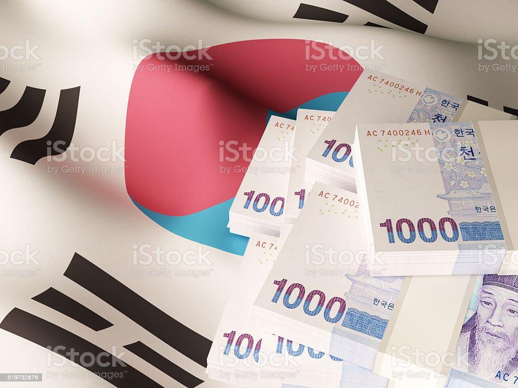 Korean won banknotes over South Korea flag stock photo