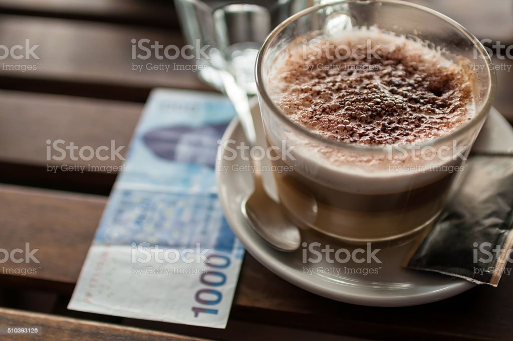 Korean Won bill and cup of coffee stock photo