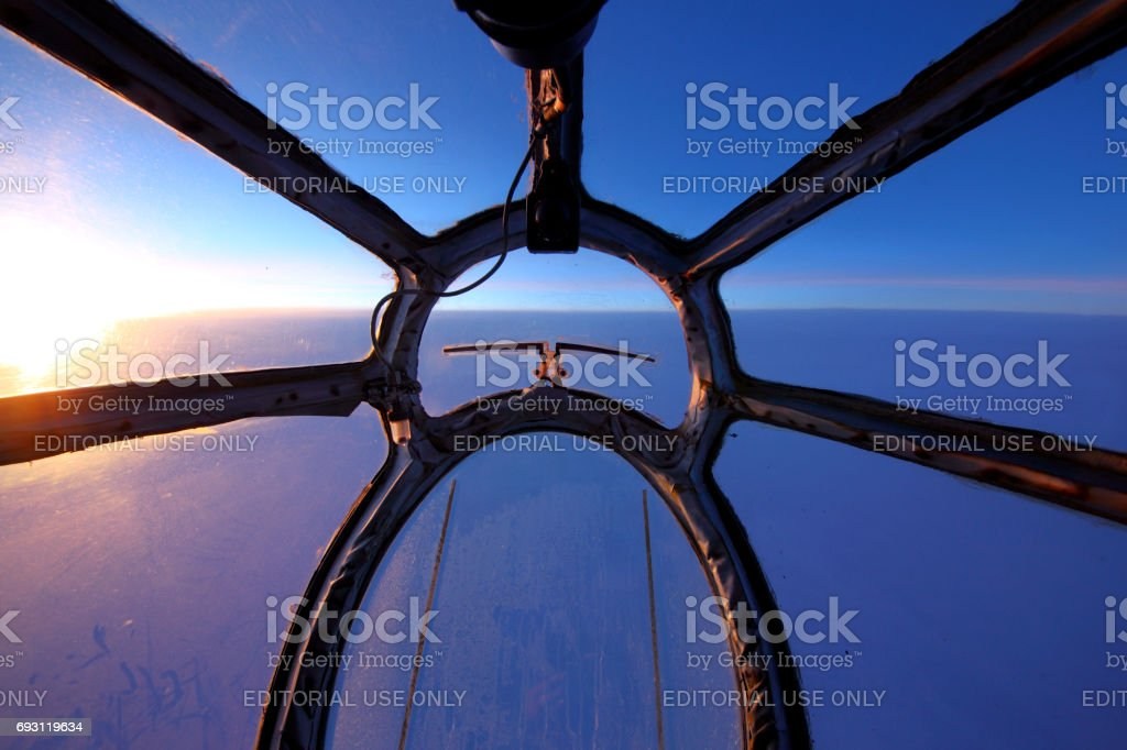 Kosmos Airlines Antonov An-12 RA-11025 view through front nose glass. stock photo