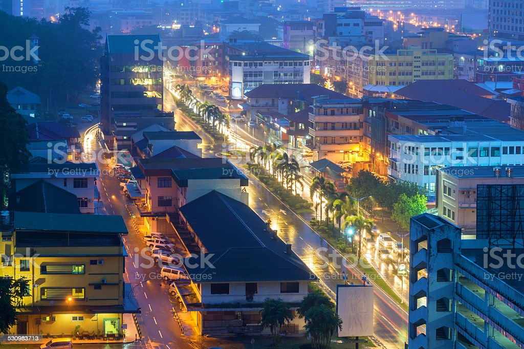 Kota Kinabalu streets view at blue hour during rainy day stock photo