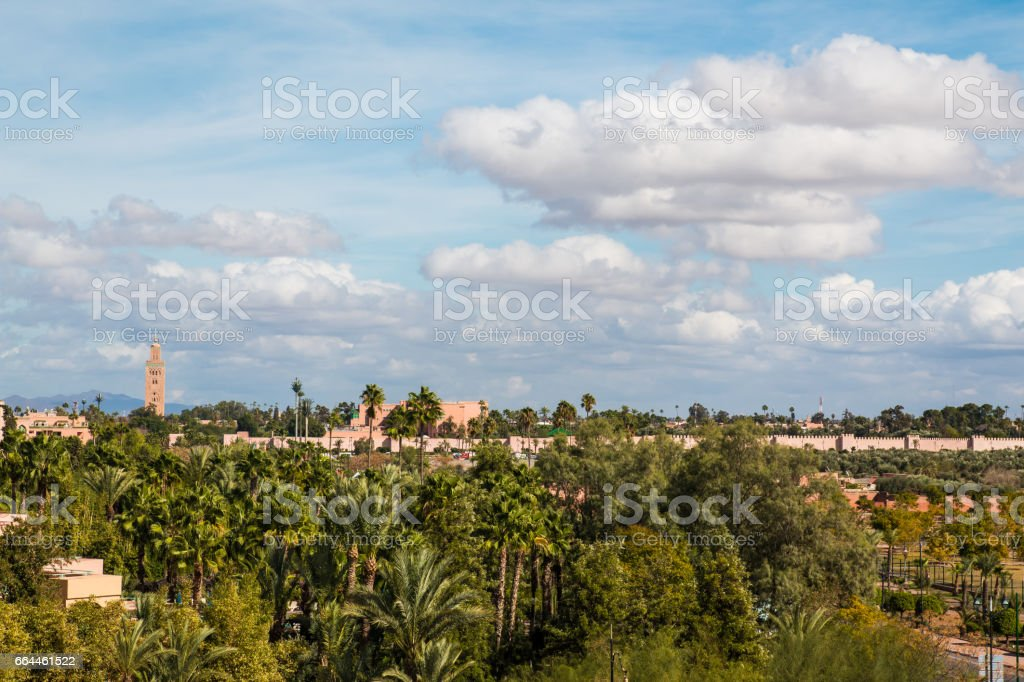 Koutoubia Mosque and palm at blue sky background stock photo