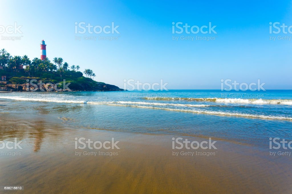 Kovalam Beach Ocean Waves Light house Outcrop H stock photo