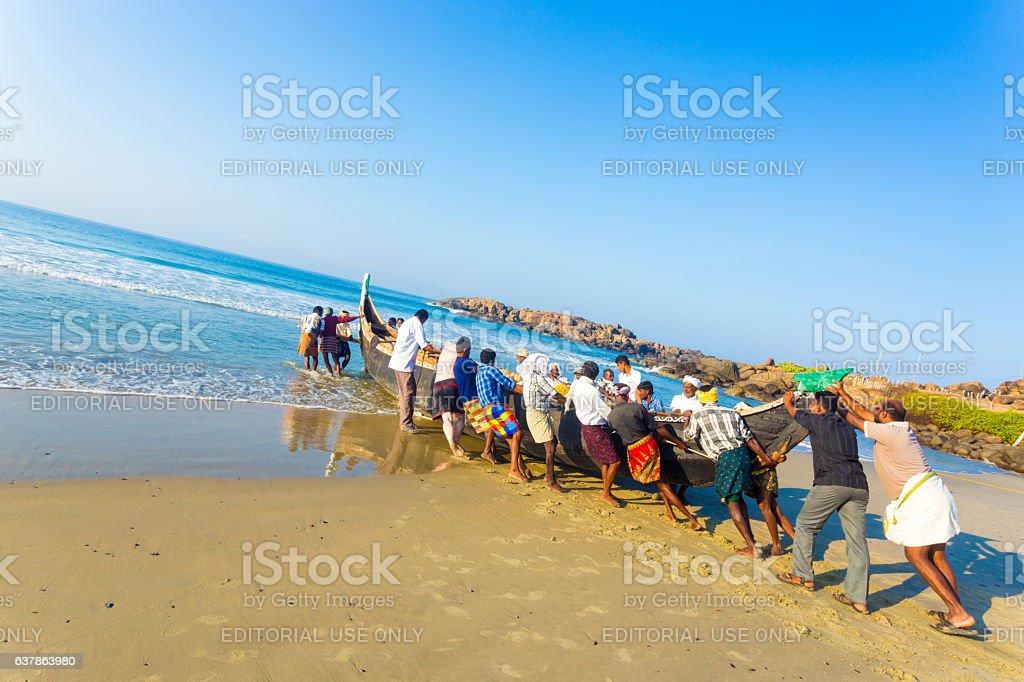 Kovalam Villagers Pushing Fishing Boat Sand Ocean stock photo