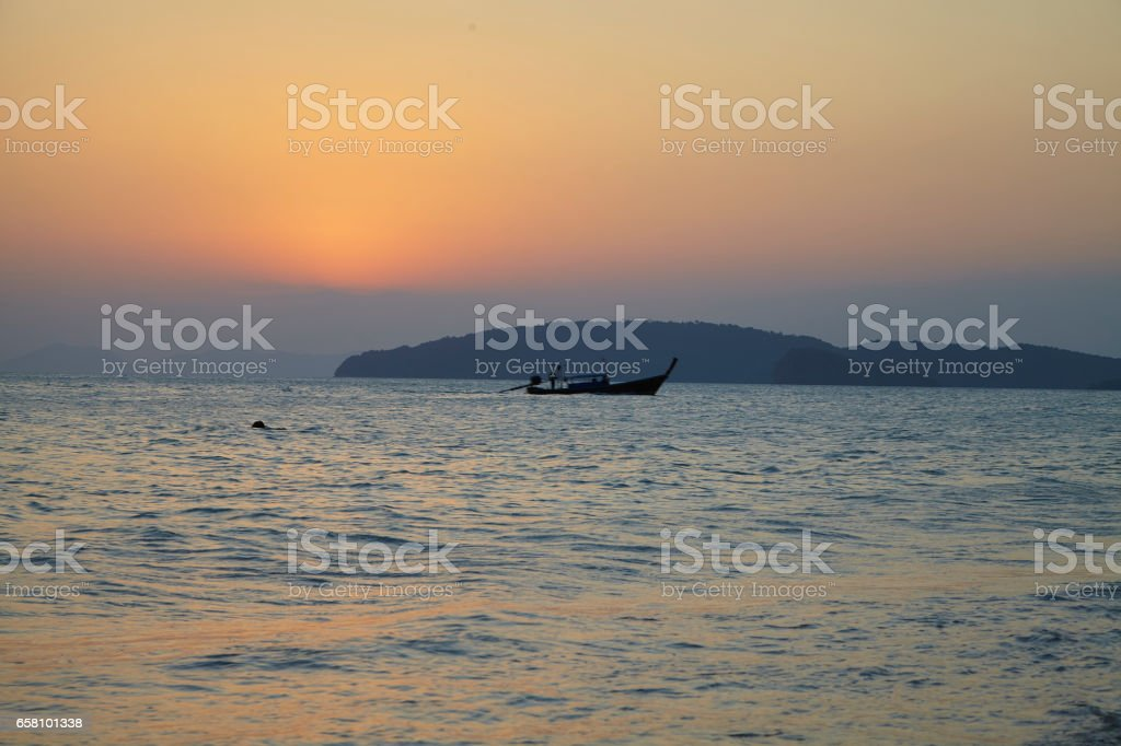Krabi Thailand boat at sunset stock photo