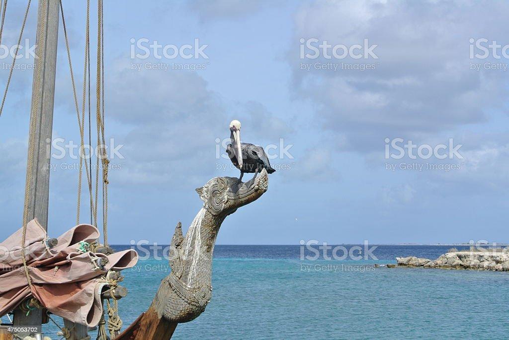 Kralendijk Pelican on old sailing boat stock photo