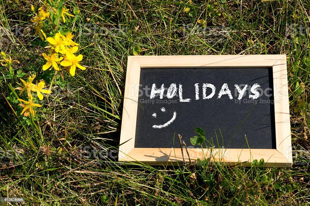 Kreidetafel und Urlaub stock photo
