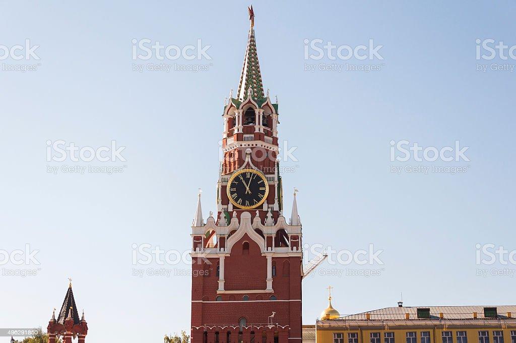 Kremlin Spasskaya tower clock over sky stock photo