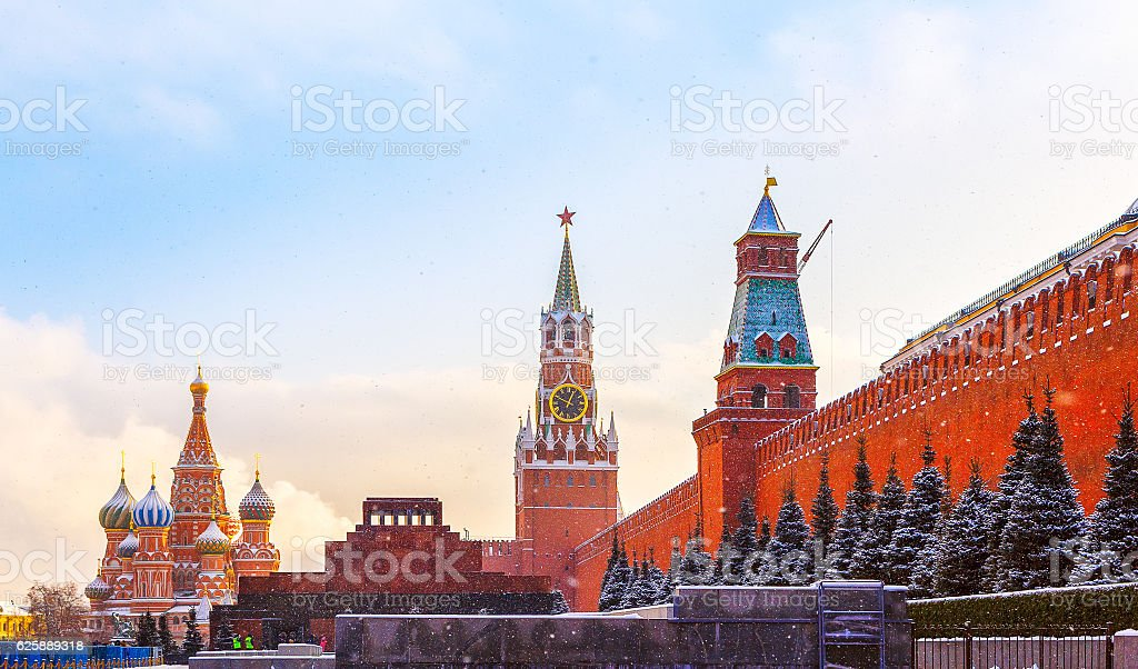Kremlin wall Spasskaya Tower Mausoleum Red Square sunset winter stock photo