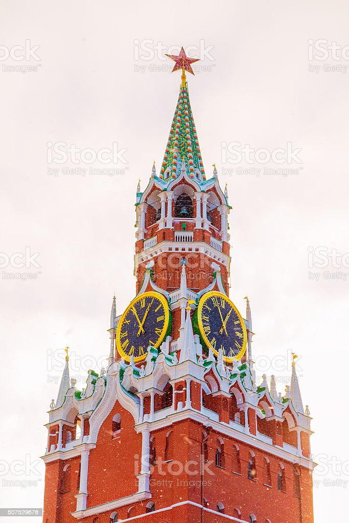 Kremlin's Spassky Tower winter snowfall sky clouds stock photo