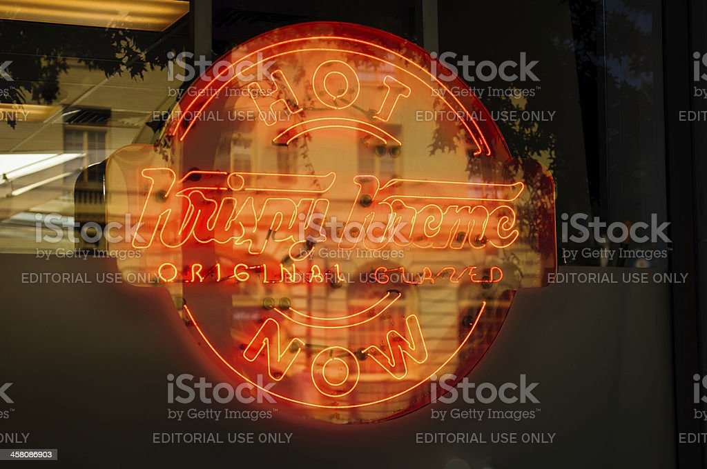Krispy Kreme Sign With Building Reflection stock photo