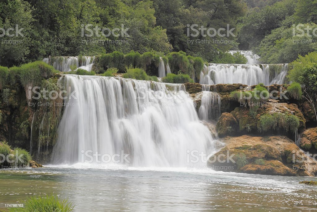 Krka Croatia cascade with streaming water rocks and green leaves royalty-free stock photo